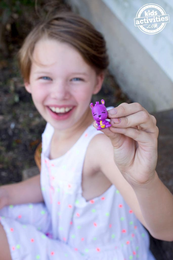 girl holding a hatchimal