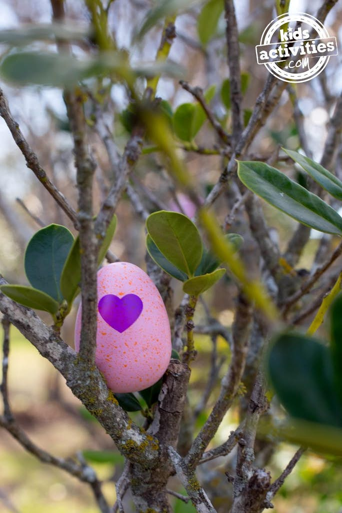Hatchimals Eggs Hidden in a tree - shown is a pink Hatchimal egg with a heart on it in a tree