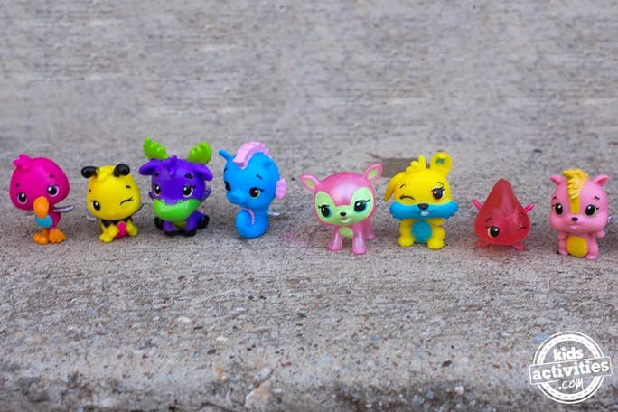 hatchimal animals from the Easter egg hunt lined up on sidewalk
