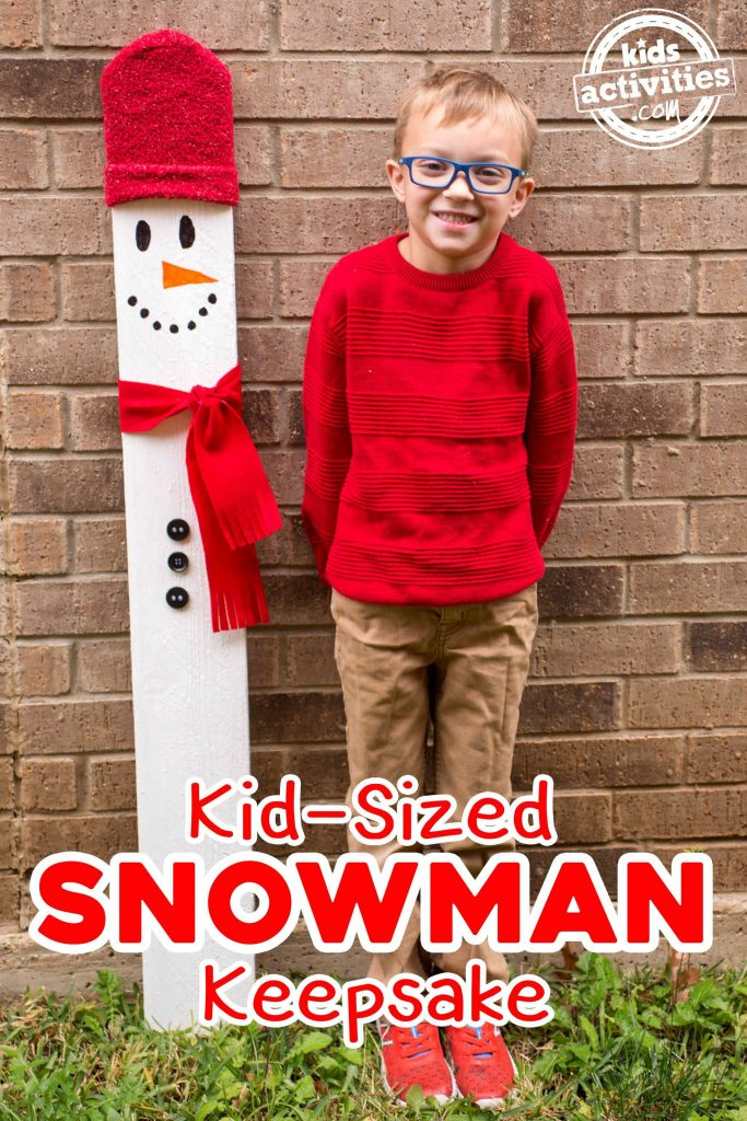 Kid Sized Snowman With Boy