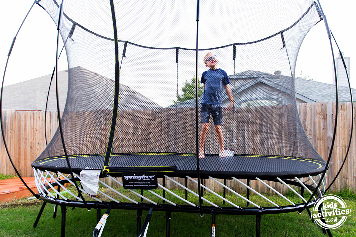 child jumping on spring free trampoline