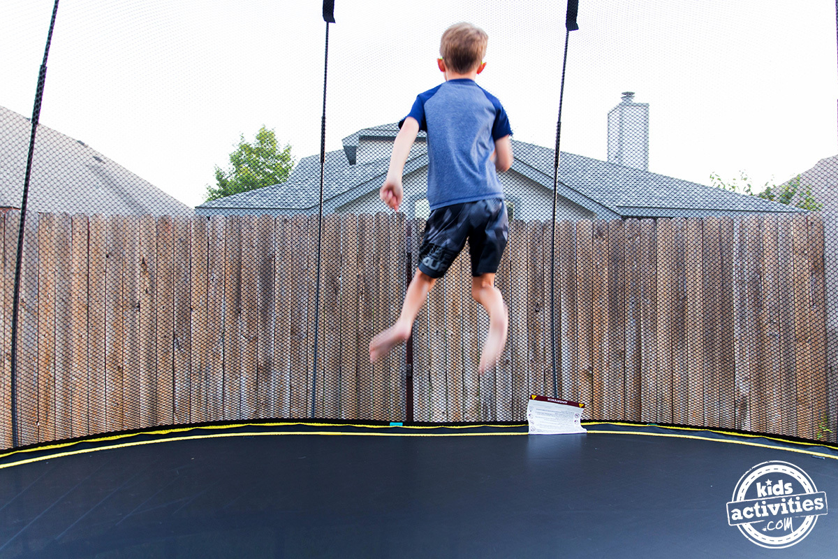 boy jumping on springfree trampoline