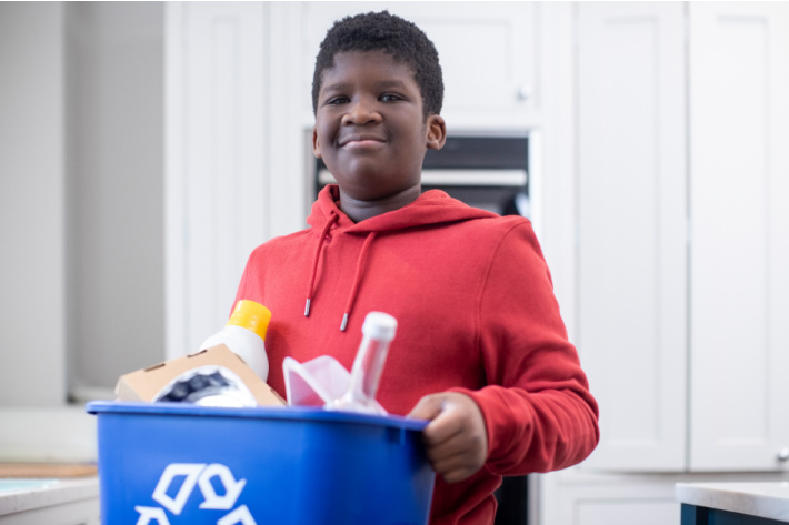 Age appropriate family chore chart - Kids Activities Blog - older boy carrying out the recycling bin