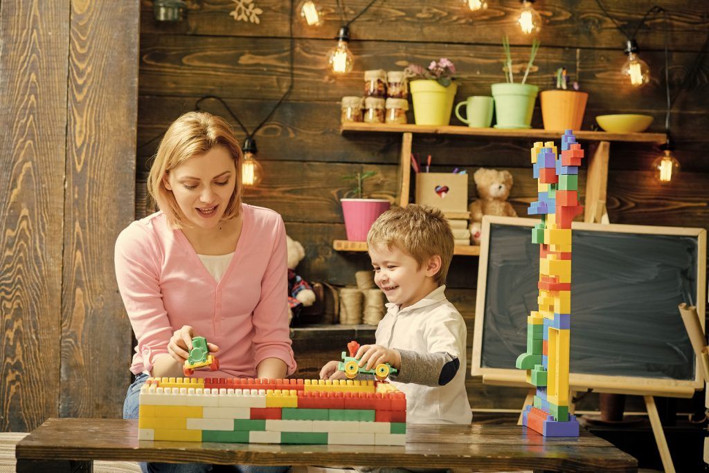 Mother And Son Play With Constructor Blocks. Mom And Kid Racing