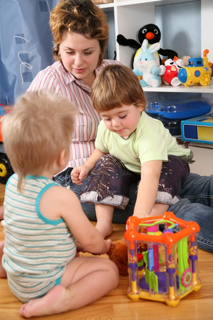 Mother And Two Children In Playroom