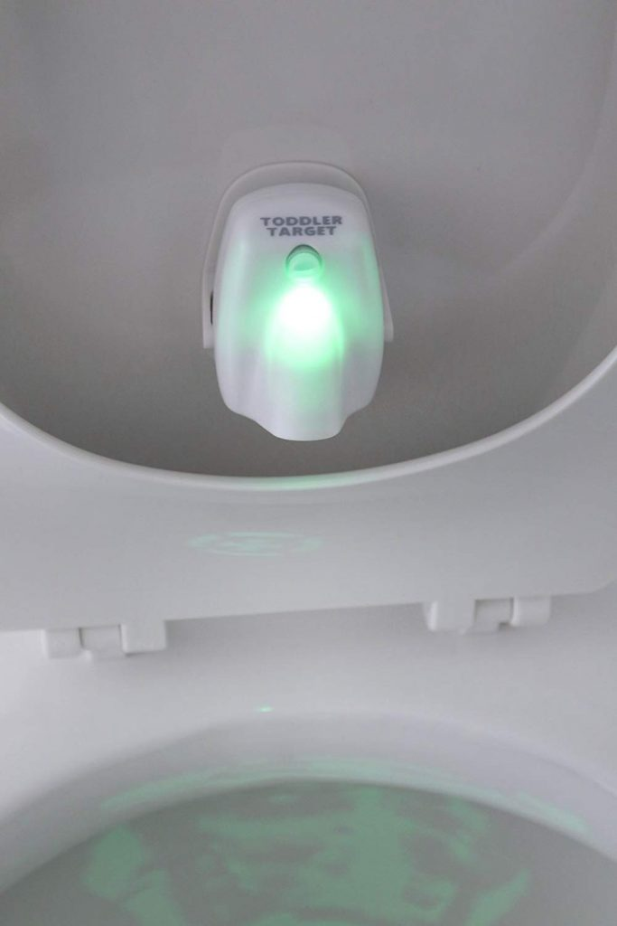 Toddler Target shown mounted on the back of the toilet seat cover