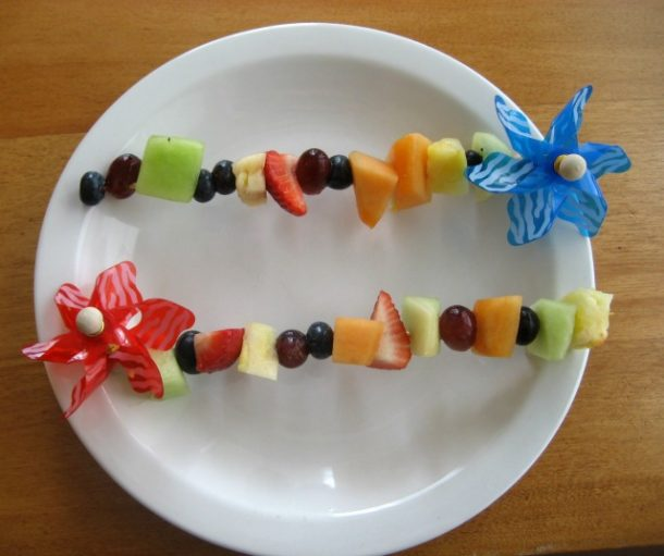 Healthy baby easter treats made with fruit impaled on pinwheels.