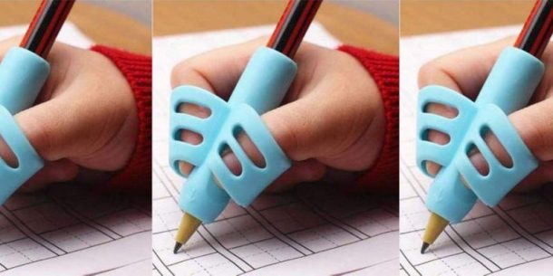 Pencil grip with small fingers writing using the pencil writing tool