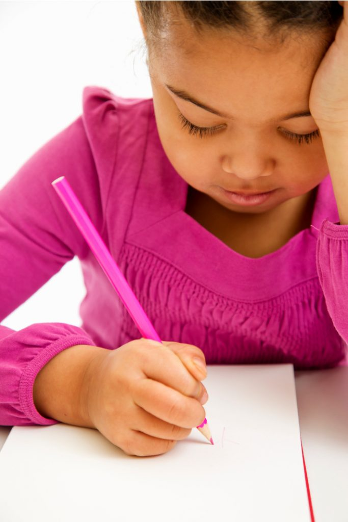 Writing tool helps kids learn to hold their pencil correctly - Kids Activities Blog - little girl writing on paper with improper pencil grip