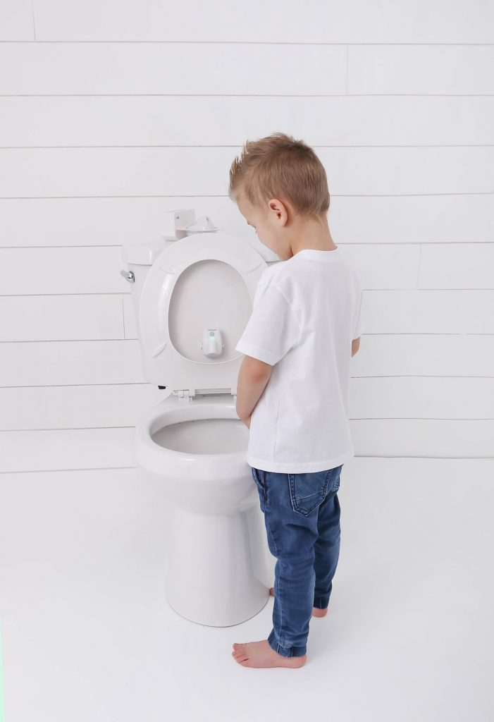 potty training target helps boys learn toilet techniques in a fun way - boy standing up to pee