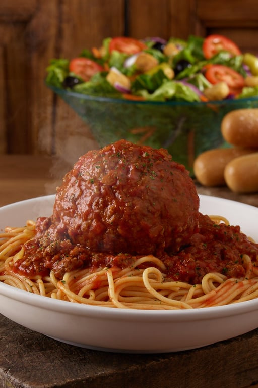 Olive Garden Just Added GIANT Meatballs and a Foot Long Chicken Parm To The Menu