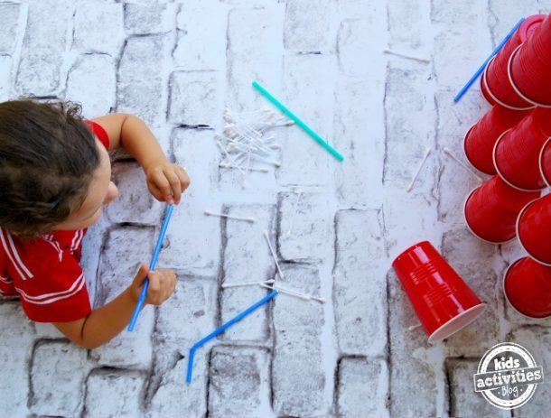 non screen activities like these cup stacking games or pick up straw games.