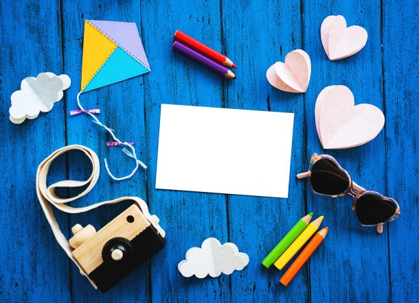 Screen free activities for kids with paper, coloring supplies, and toys.