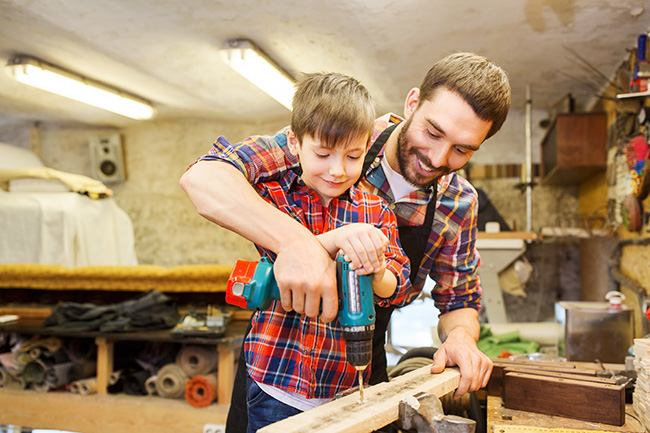 Father and Son building a project together