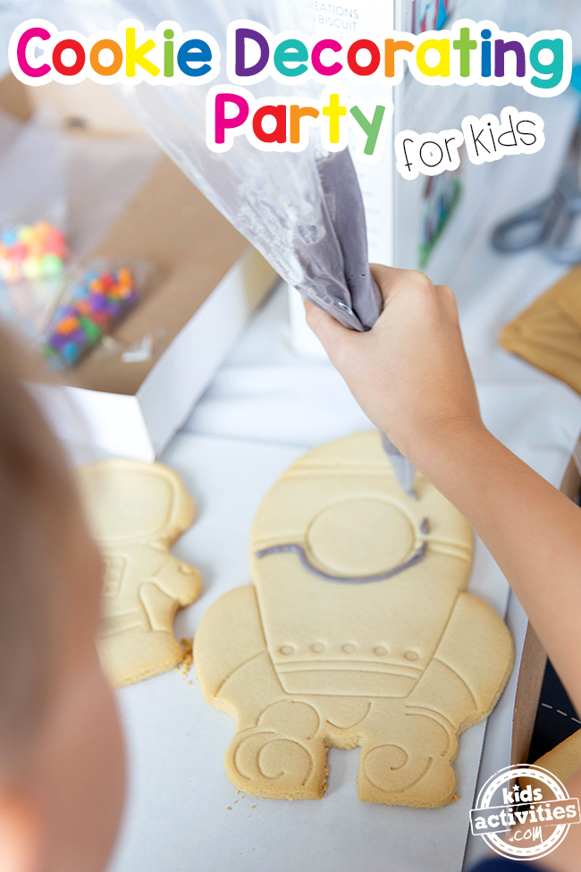 Cookie Decorating Party For Kids with a spaceship and gray frosting