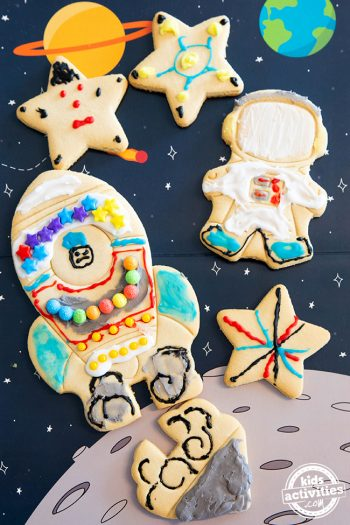 Space cookies with stars, spaceships against an outerspace background. Perfect for a cookie party.