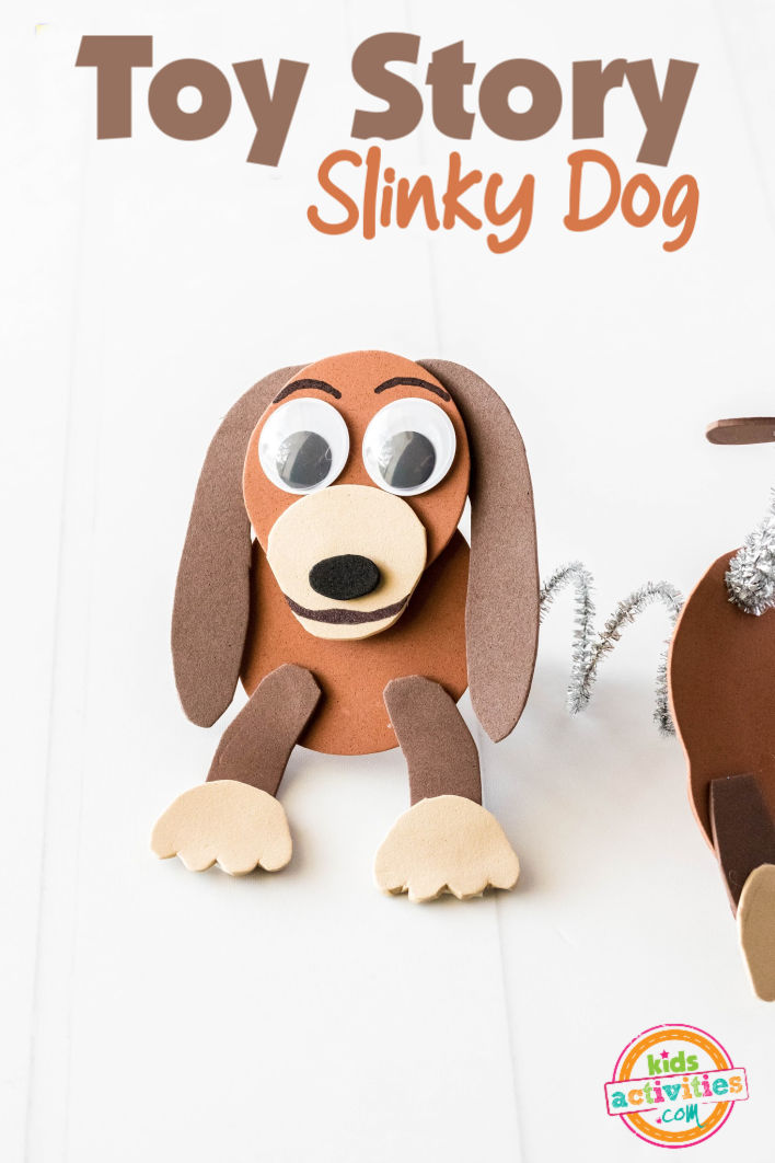 Toy Story Slinky Dog craft made from foam paper and pipe cleaners, arranged in a cute pose with the slinky between his front and rear, on a bright white background