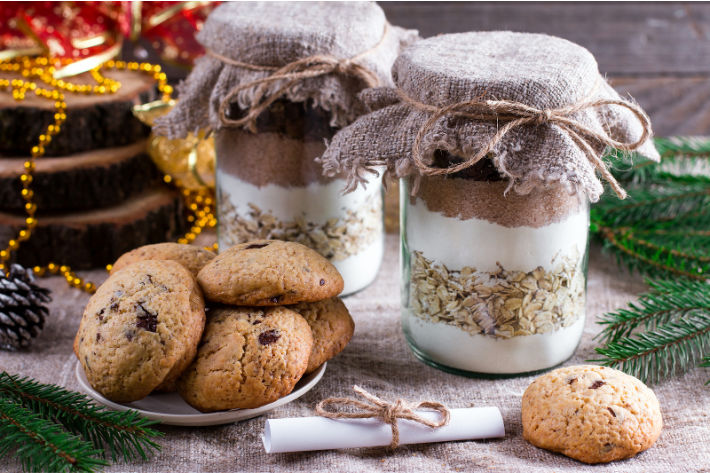 cookie ingredients in a jar - Mason jar gifts - with a plate of cookies