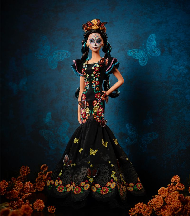 Day of the Dead Barbie 2019 pictured on dark background with marigolds