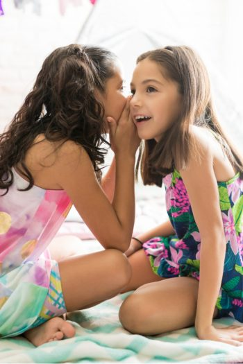 Games for Girls - fun games for girls to play - Kids Activities Blog - two girls playing a game of telephone at slumber party