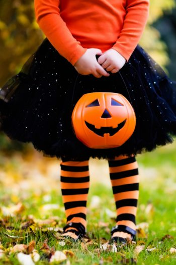 Homemade Halloween Costumes For kids with a jackolantern and a little girl in black and orange tights, black tutu and orange shirt