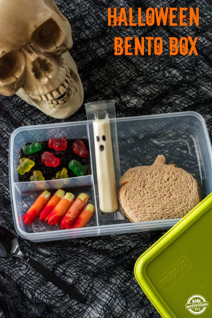 Halloween lunch box ideas for kids - bento box shown with Halloween background