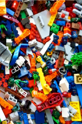 Assorted Legos going to be recycled. Many are small colorful pieces like yellow, orange, blue, green, red, white, and are random pieces to bigger sets.