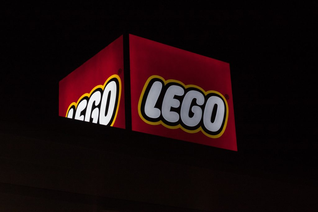 The logo for Legos looking all great and glowy against a black backdrop