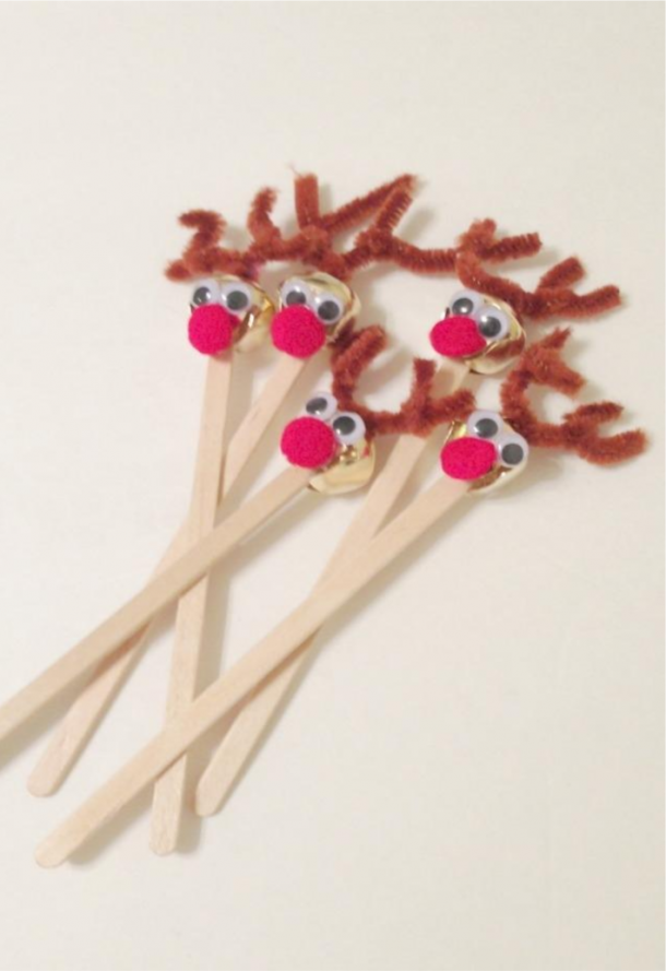Reindeer Drink stirrers made from bells, red pom poms, and popsicle sticks.