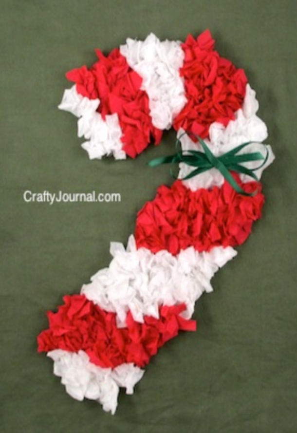 scrunched white and red paper candy cane with a green bow
