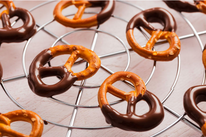 Chocolate dipped pretzels sitting on a wire rack to cool - Kids Activities Blog - cooling dipped pretzels