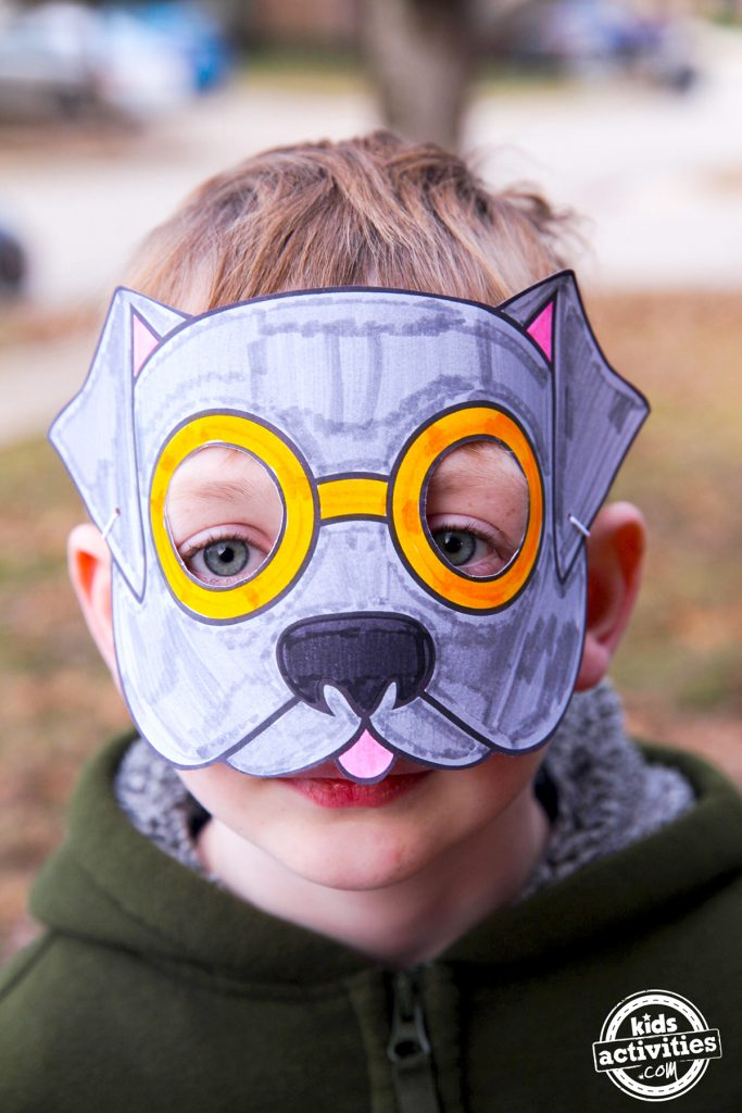 Dolittle Dog Mask colored in grey, with pink ears and yellow glasses
