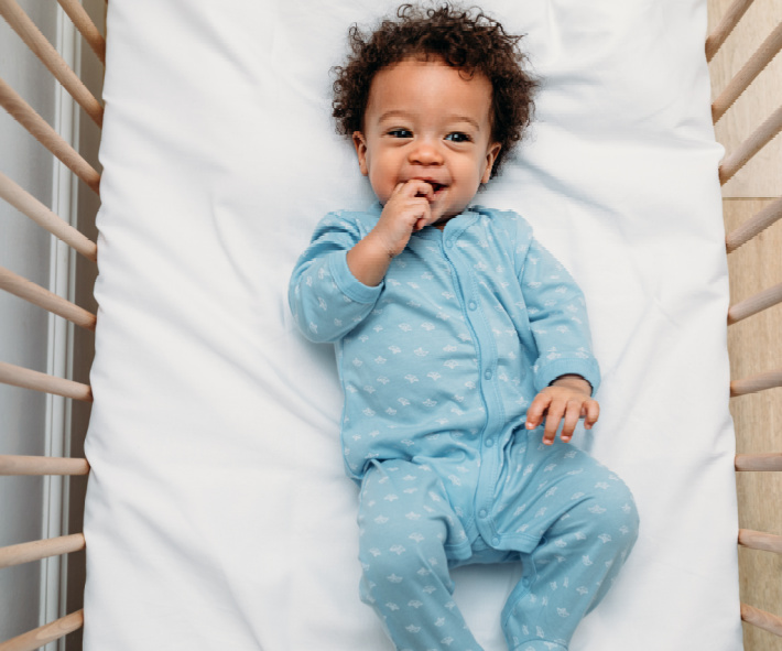 Top Boy Baby Names of the Decade - Most popular baby names for boys - Kids Activities Blog - baby boy sleeping in a crib
