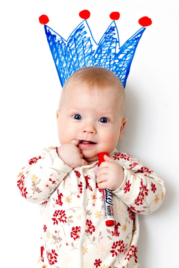 top baby names of the decade - baby shown with a drawn crown on her head