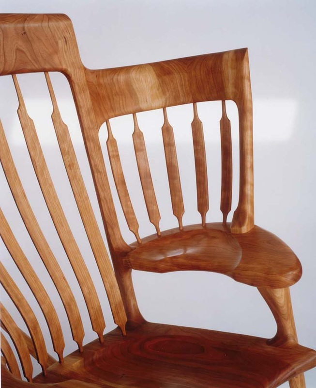 rocking chair design with smaller seats on either side for children