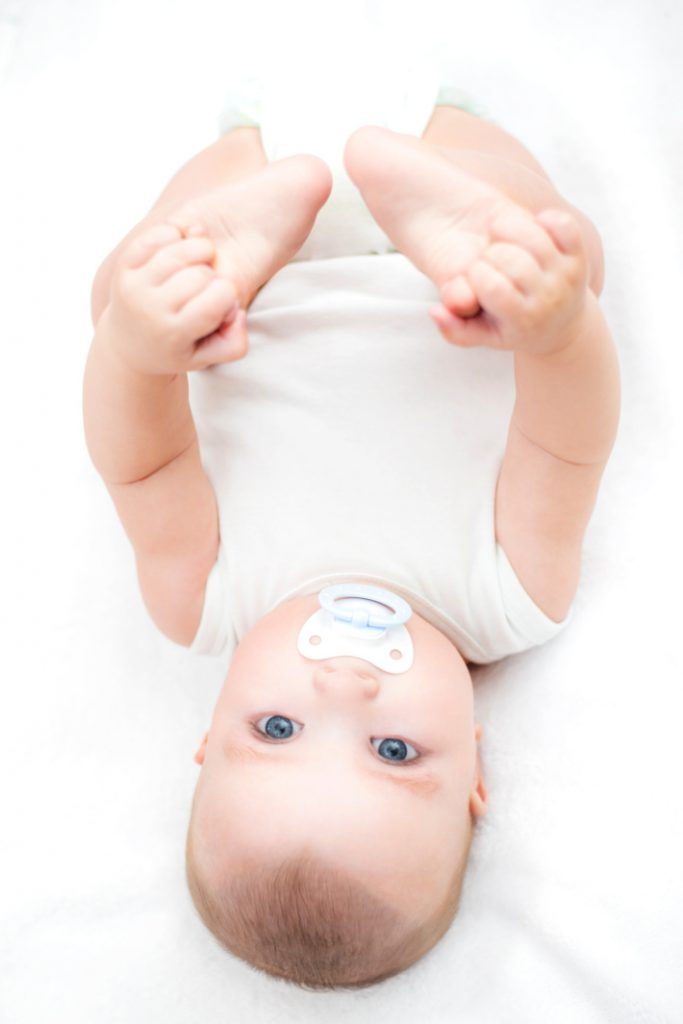 Baby Pacifier Sleep Hack for Parents that Works - Kids Activities Blog - baby with pacifier in mouth