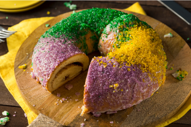 Homemade King Cake Recipes Ideas from Kids Activities Blog - homemade King Cake on cutting board with slice