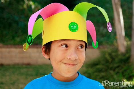 Mardi Gras jester hat craft from AllParenting - boy in homemade jester hat craft laughing