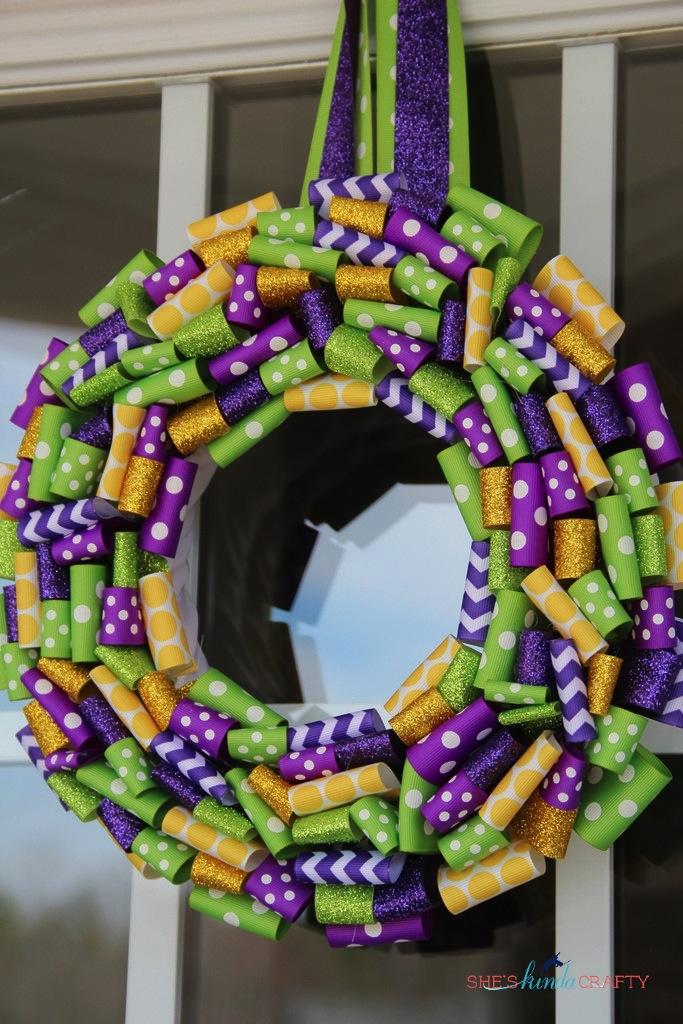 Homemade Mardi Gras ribbon wreath from Shes Kinda Crafty - homemade wreath hanging on front door