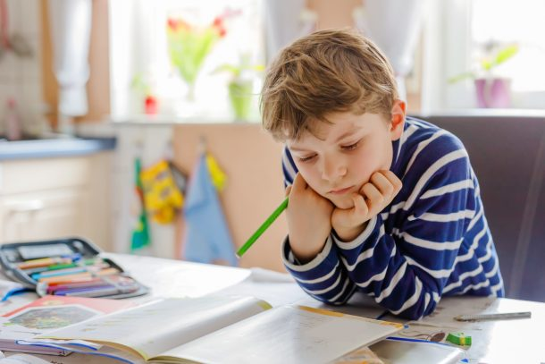 learn the letter B - preschool boy reading and writing