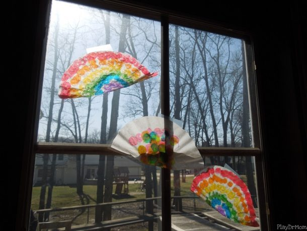coffee filter rainbow rainbow craft for St. Patrick's day using dotting pens, tape, and coffee filters.