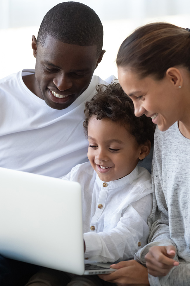 family taking free online field trip from laptop