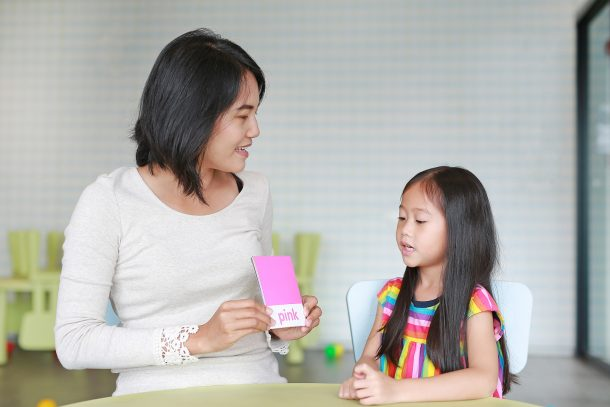 Words that start with D - mom and preschool girl practicing with flashcards