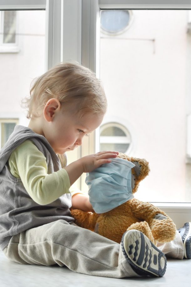 toddler with bear in face mask coronavirus
