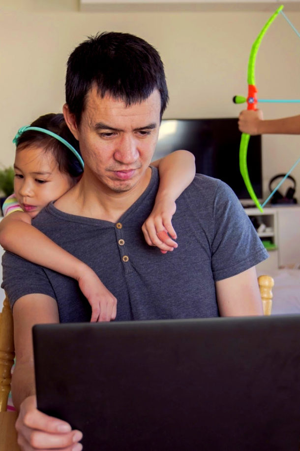 father work from home with child during coronavirus