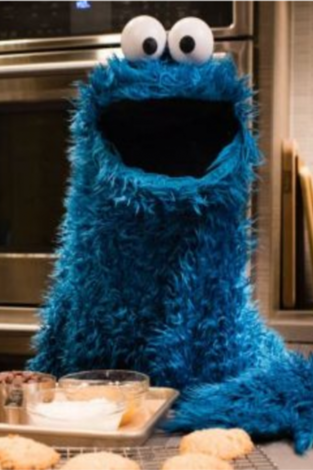 cookie monster show with cookie monster and cookies and a stove and snacks.