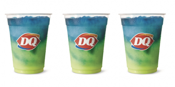 3 cups of lemonade twisty misty slushies from dairy queen in a clear cup. The slush is blue, green, and yellow.
