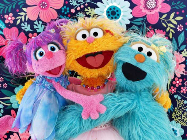 sesame street characters together supporting each other