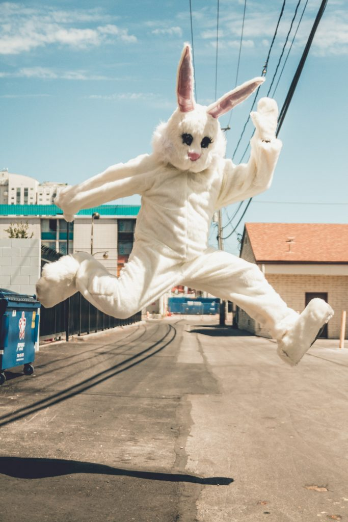Happy Easter bunny jumping in the middle of the street - watch progress with Easter Bunny tracker