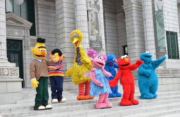 sesame street characters on the museum steps dancing